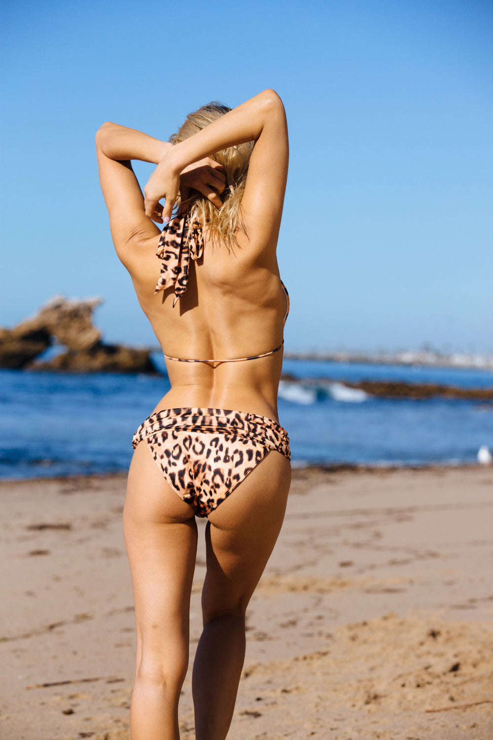 leopard bikini bottom full covereage eco-friendly sustainable | Model is wearing size S