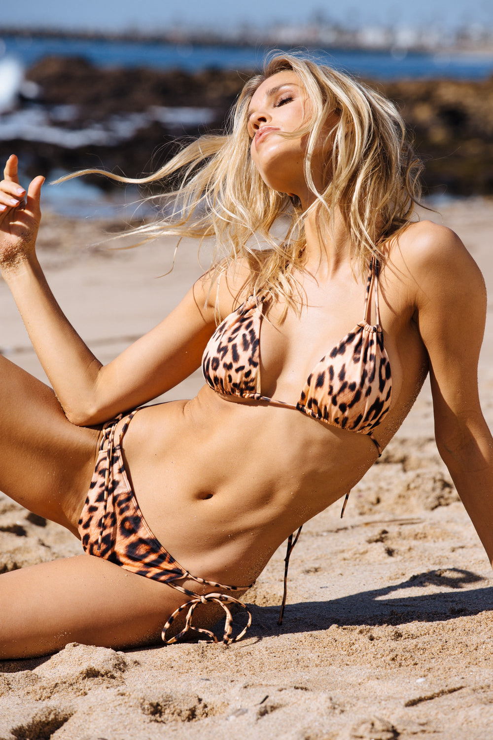 leopard cheetah print cheeky bikini bottom with side ties - eco-friendly & sustainable |  Model is wearing size S