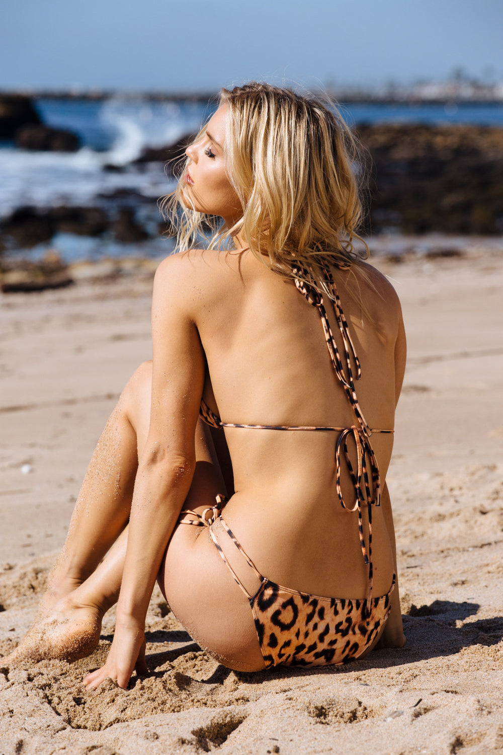 leopard cheetah print cheeky bikini bottom with side ties - eco-friendly & sustainable | Model is wearing S