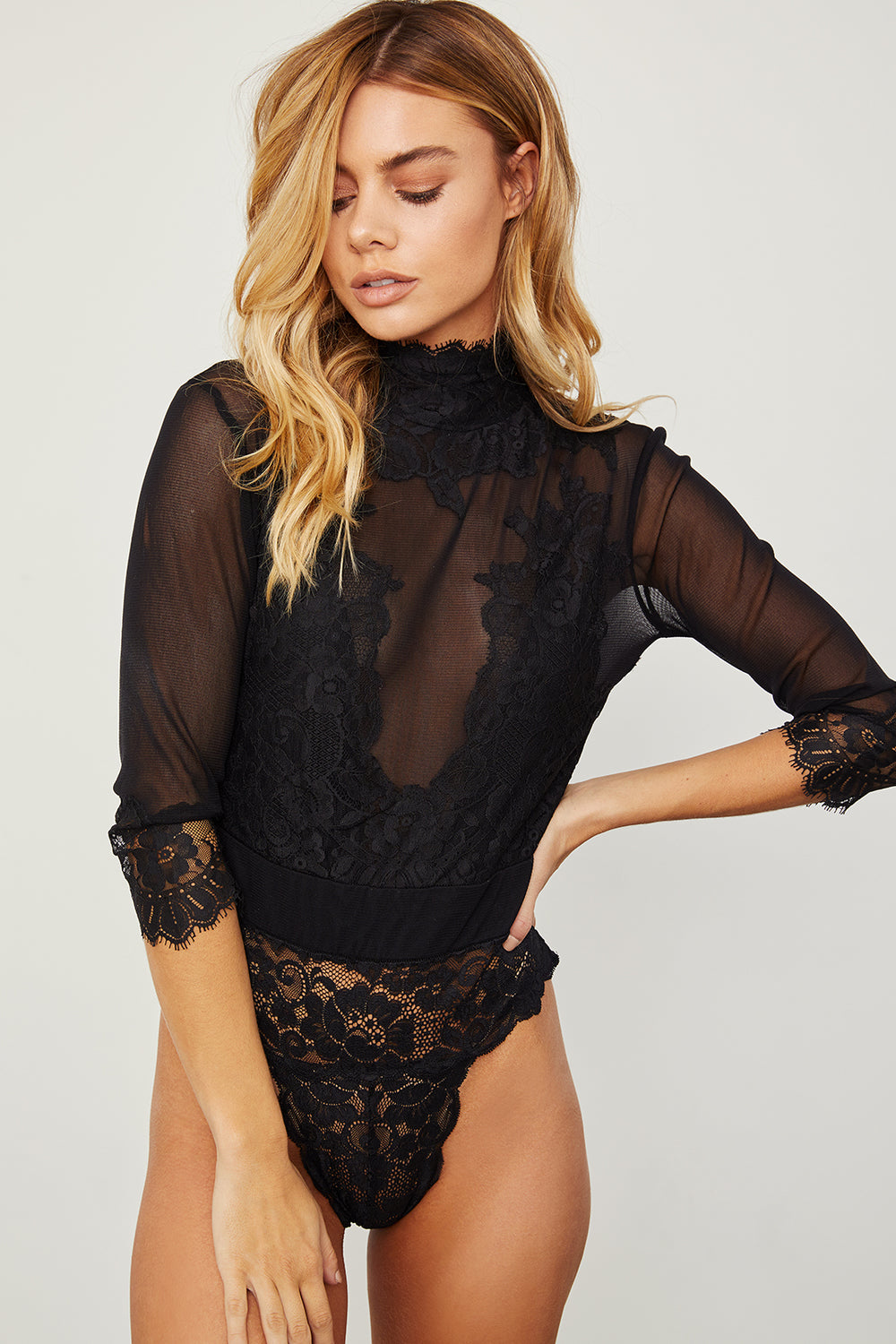 revolve black reversible vintage inspired mesh and lace high neck bodysuit| Model is wearing Size S