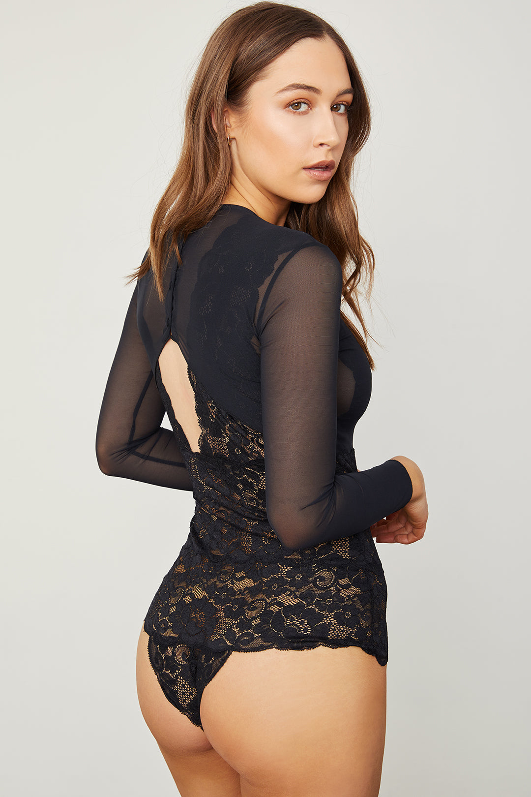 Black elegant stretch mesh & lace long-sleeved bodysuit with a deep V-Neck & allover coverage.