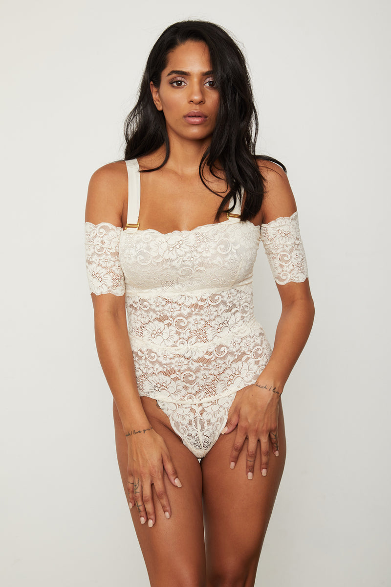Cream-white lace off-the-shoulder thong-back bodysuit.