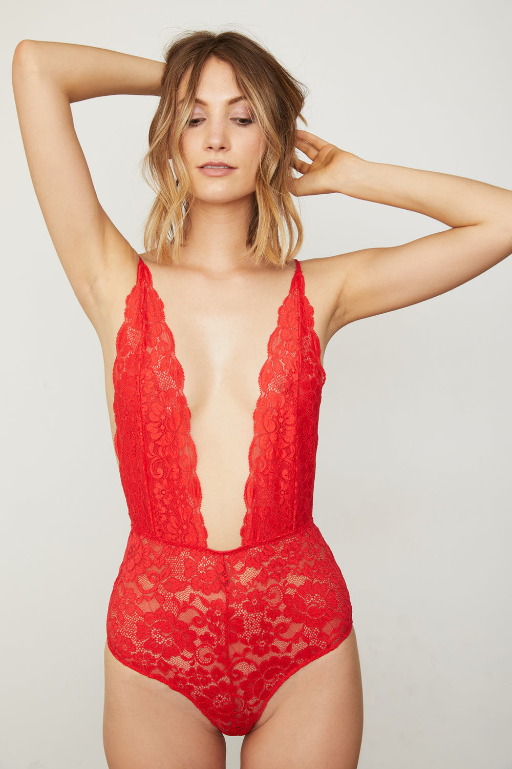 red lace deep v-neck bodysuit | Model is wearing size S