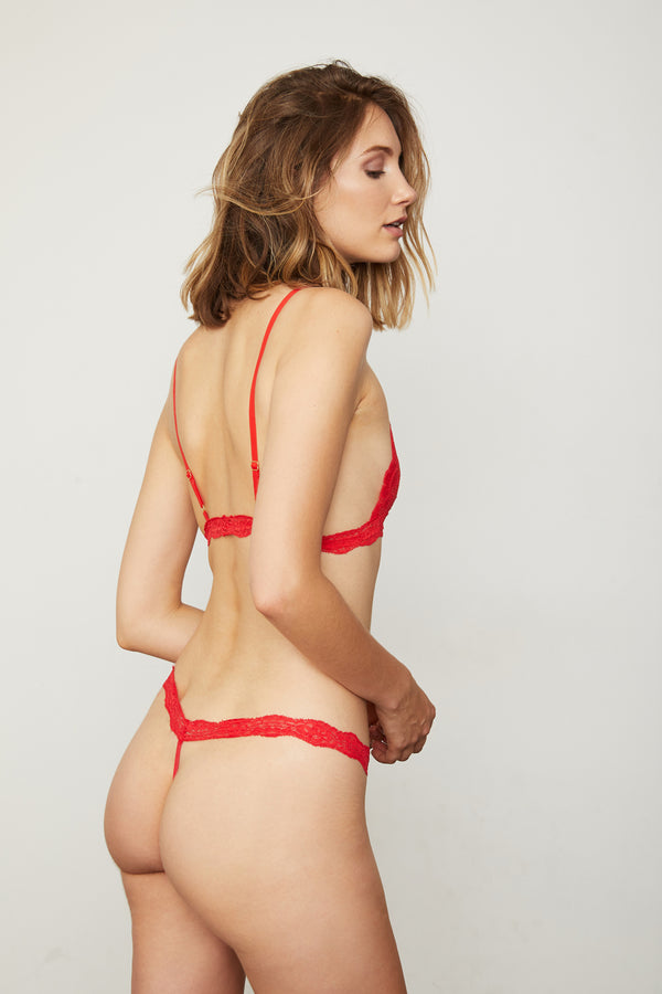Red lacy t-string thong panty. | Model is wearing Size S