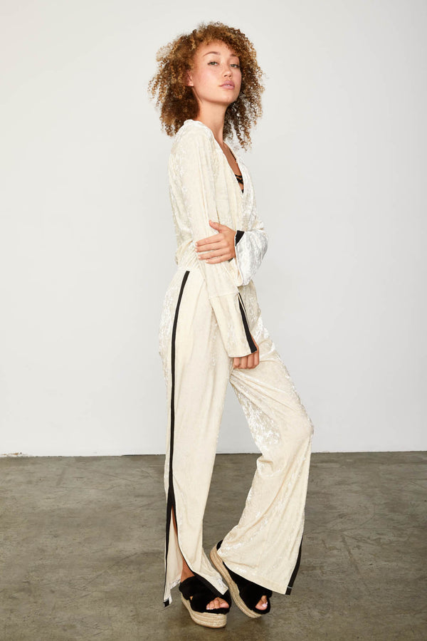 white velvet vintage inspired long sleeved jumpsuit