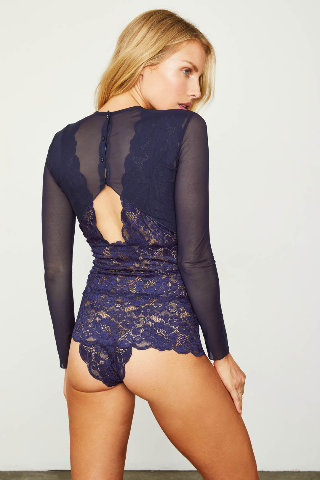 Dark navy blue elegant stretch mesh & lace long-sleeved bodysuit with a deep V-Neck & allover coverage.