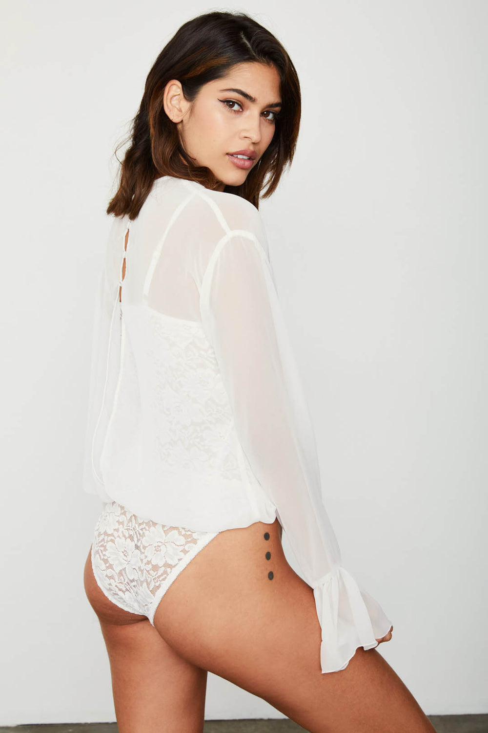 white chiffon bodysuit with lace underlay and bell sleeve machine washable | Model is wearing size S