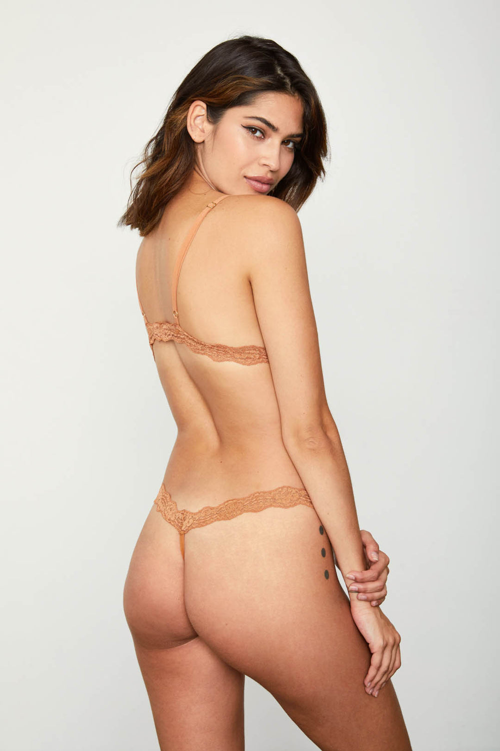 Brown lace thong panty.