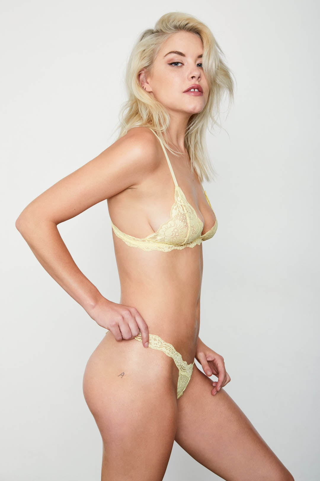 Light yellow lace thong panty.