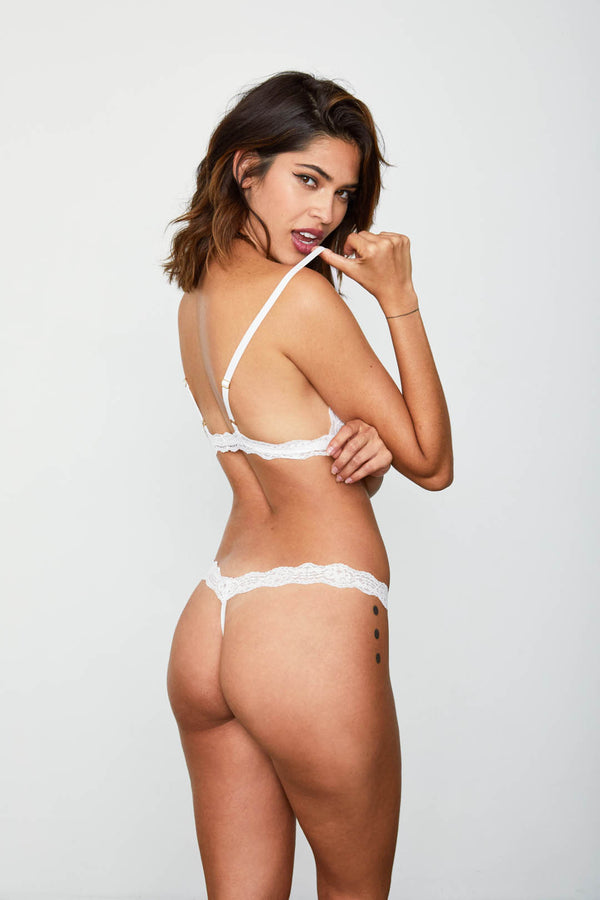 White lace thong panty. | Model is wearing Size S
