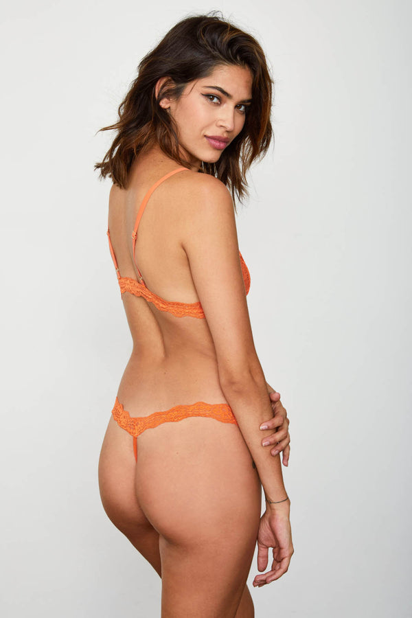 Orange lace thong panty. | Model is wearing Size S