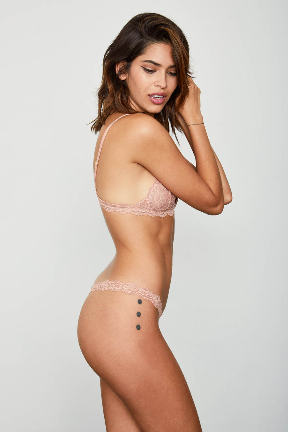 Rose pink lace thong panty. | Model is wearing Size S
