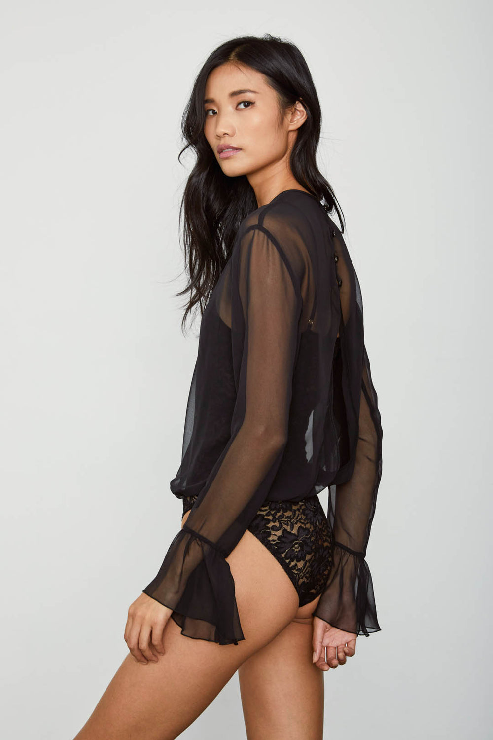 black chiffon bodysuit with lace underlay and bell sleeve machine washable | Model is wearing size S
