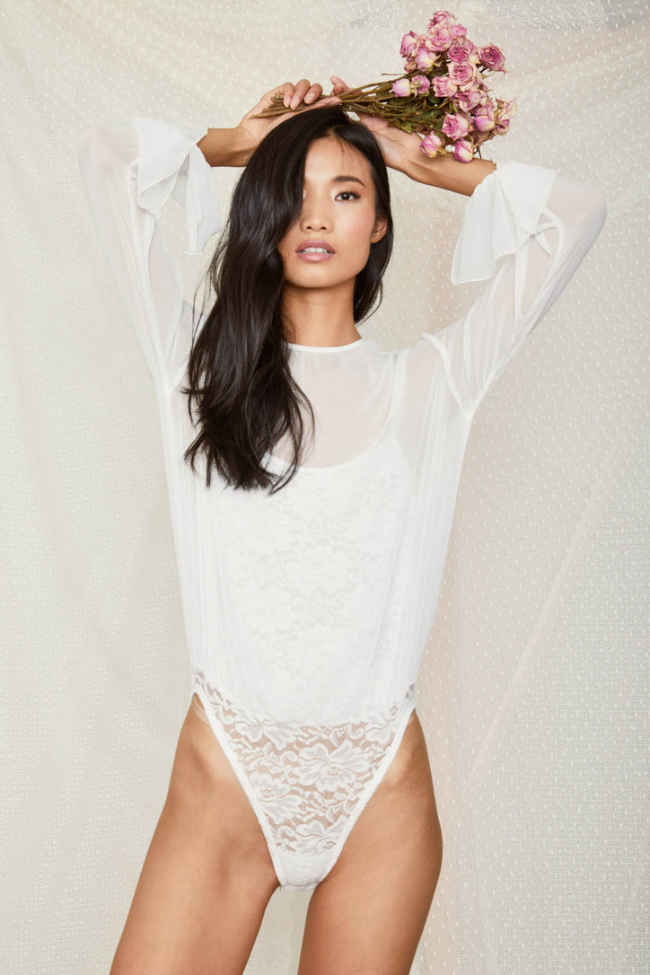 white chiffon bodysuit with lace underlay and bell sleeve machine washable