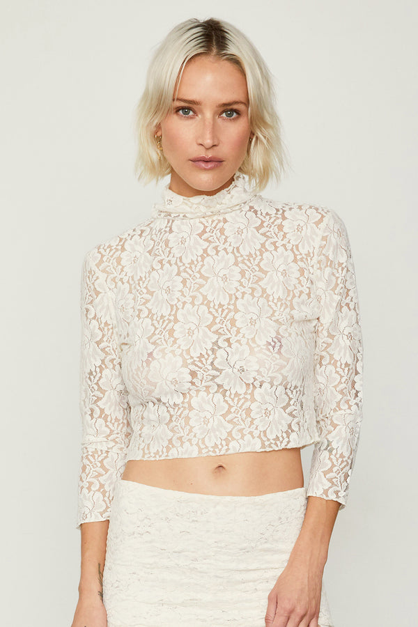 white lace turtleneck long sleeve crop top