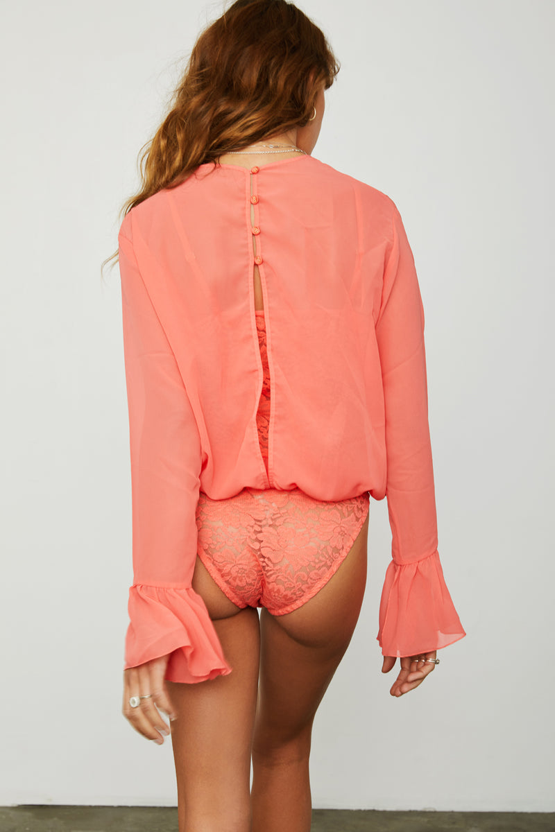 coral peach chiffon bodysuit with lace underlay and bell sleeve machine washable