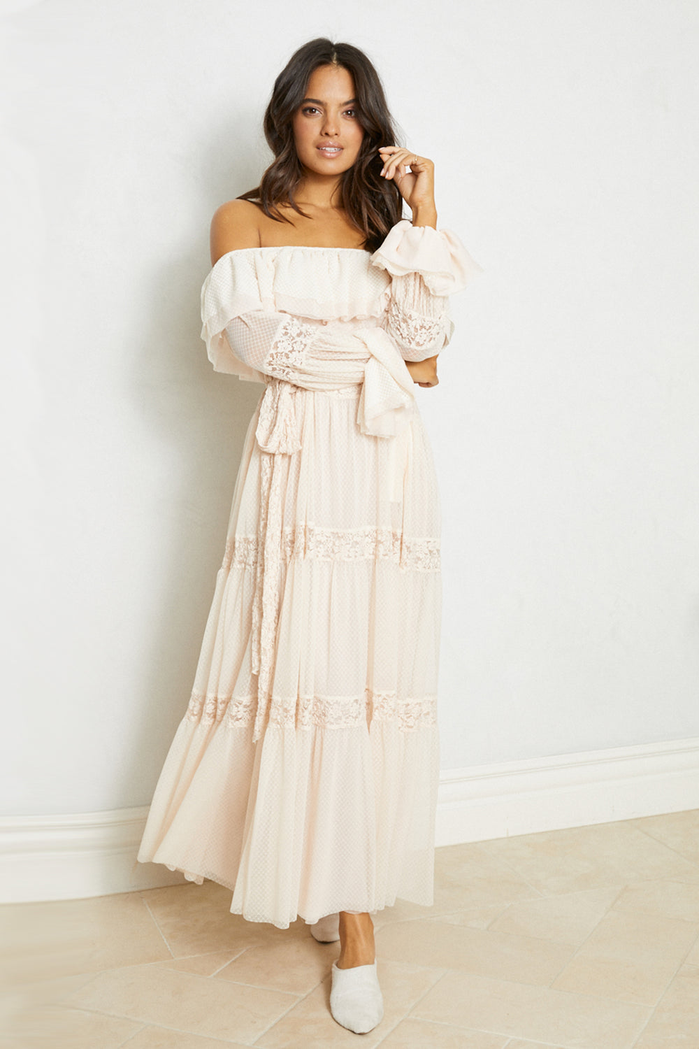Cream off the shoulder vintage inspired lace ruffle maxi dress with sleeves. | Model is wearing Size XS/S
