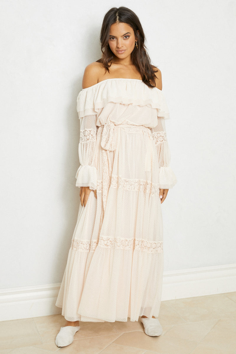 Cream off the shoulder vintage inspired lace ruffle maxi dress with sleeves.