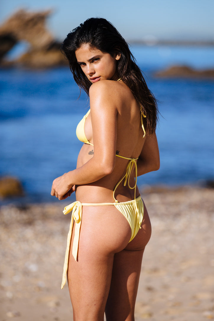 light yellow vintage inspired side-tie cheeky bikini bottom eco-friendly & sustainable fabric