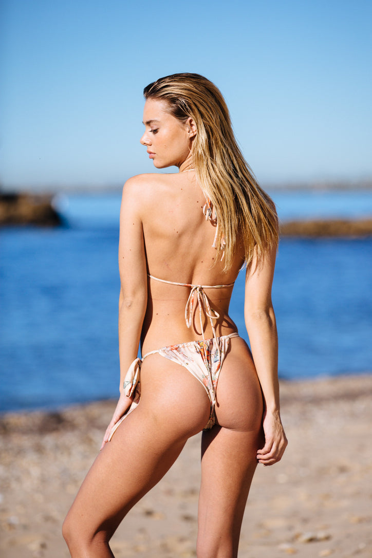 nude floral print vintage inspired side-tie cheeky bikini bottom eco-friendly & sustainable fabric