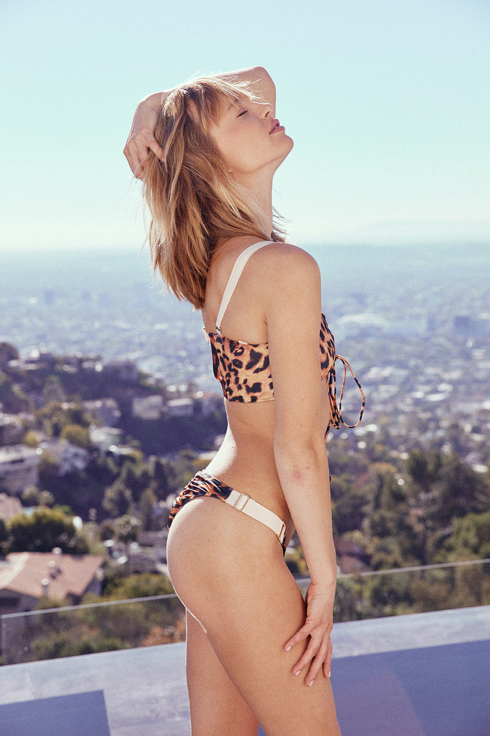 leopard print adjustable cheeky swimsuit bottom high-cut eco-friendly sustainable | Model is wearing size S