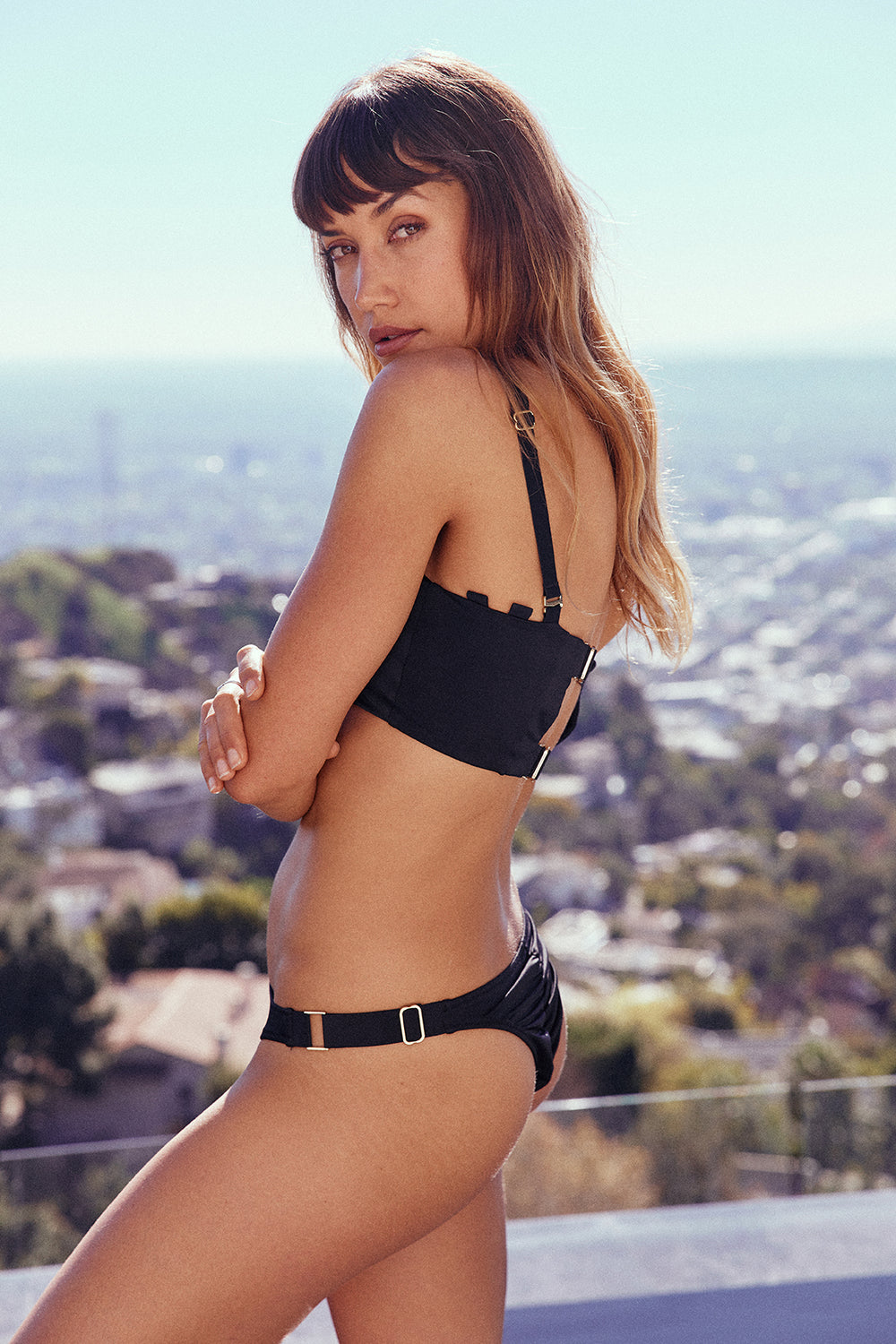 Black lace-up bandeau vintage inspired bikini top eco-friendly & sustainable fabric | Model is wearing S