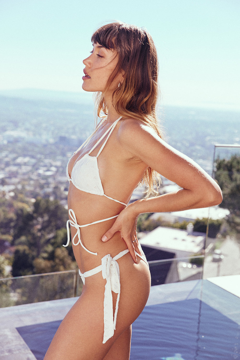 white eyelet vintage inspired side-tie cheeky bikini bottom eco-friendly & sustainable fabric | Model is wearing S