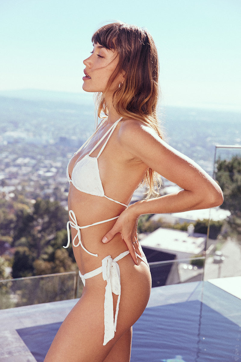 white eyelet vintage inspired side-tie cheeky bikini bottom eco-friendly & sustainable fabric
