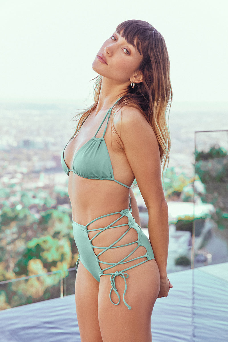 light green vintage inspired high waisted bikini bottom moderate coverage eco-friendly & sustainable fabric