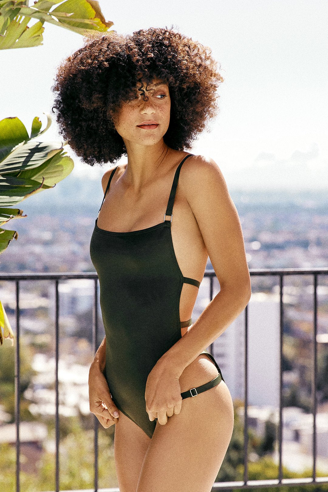 dark green one piece vintage inspired open back bottom moderate coverage eco-friendly sustainable