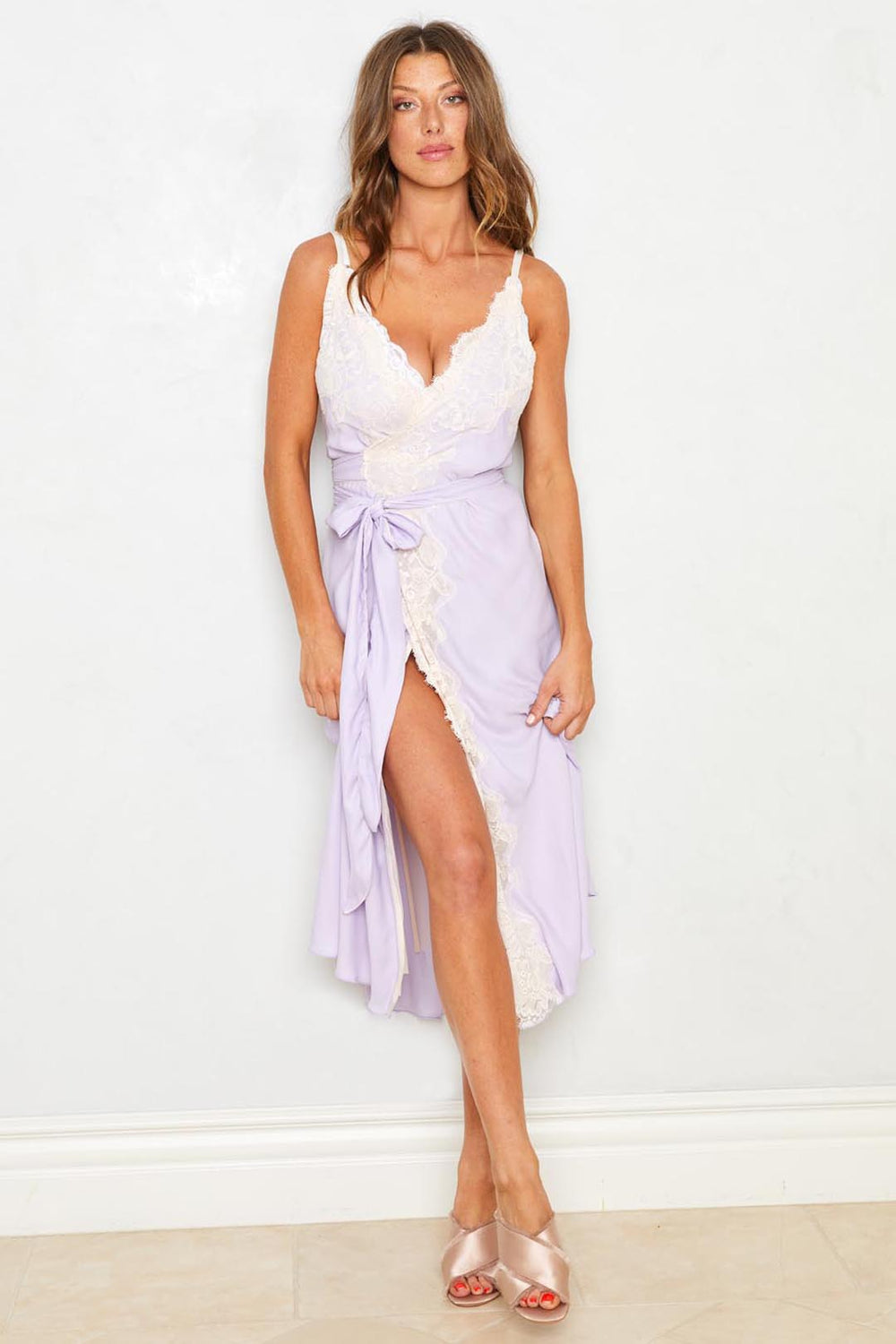 Purple ruffled slip dress with adjustable waist. Machine washable.| Model is wearing Size S