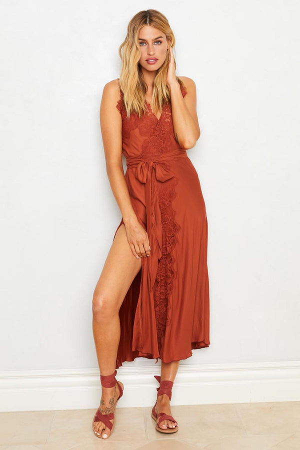 Brown ruffled slip dress with adjustable waist. Machine washable.| Model is wearing Size S
