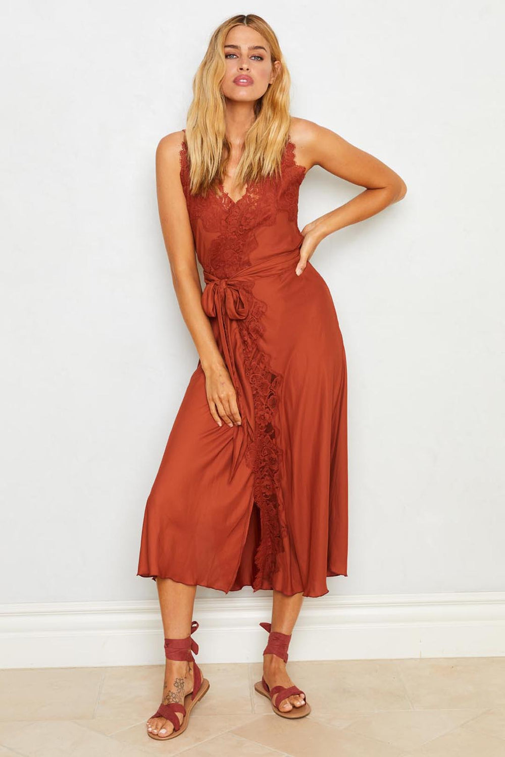 Brown ruffled slip dress with adjustable waist. Machine washable.