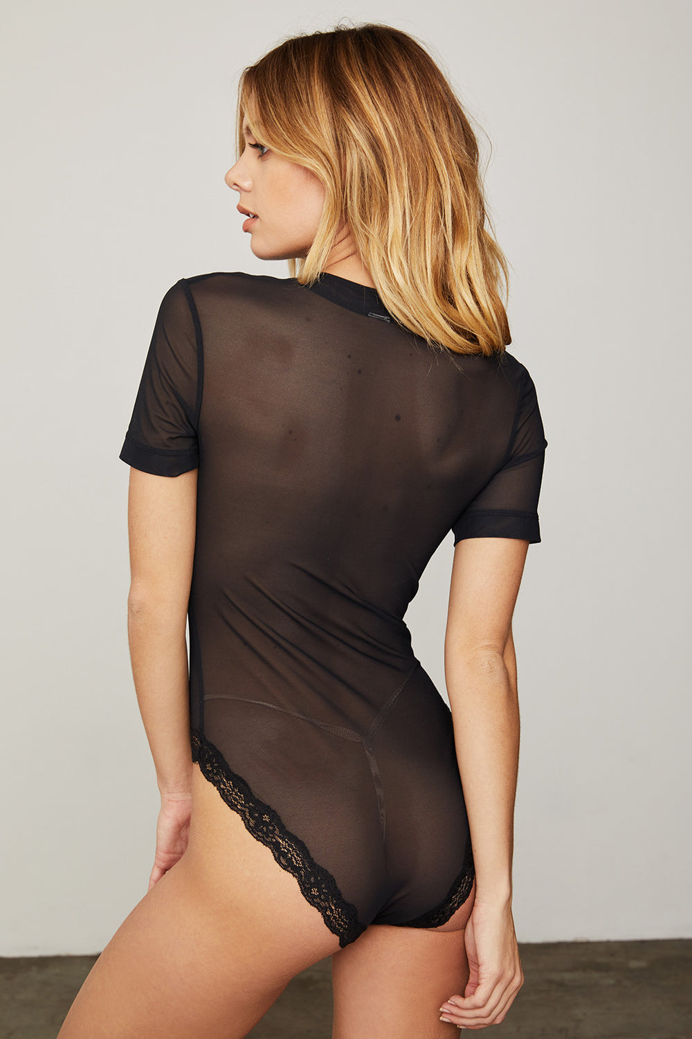 black mesh bodysuit short sleeve sexy |  Model is wearing size S
