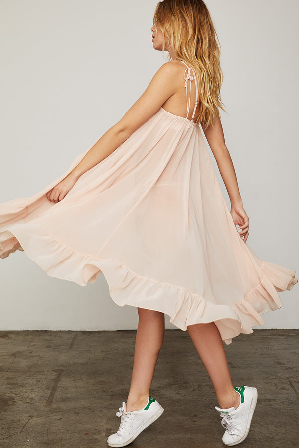 light pink spaghetti strap midi dress with ruffles made of chiffon machine washable | Model is wearing size XS/S
