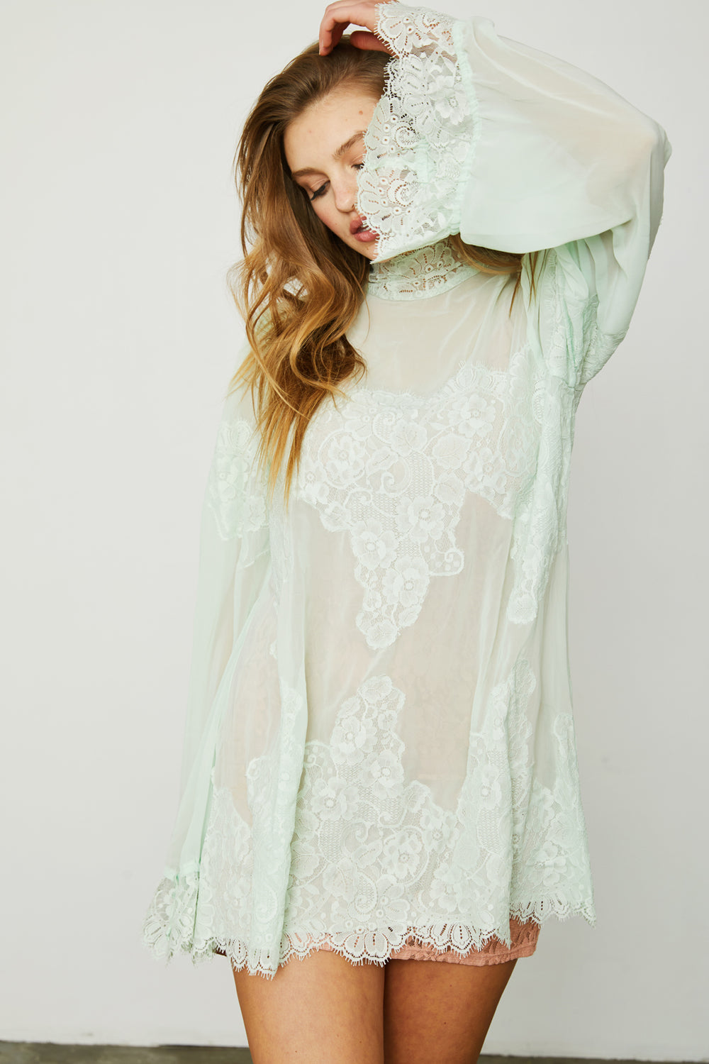 sea foam green lace and chiffon victorian high neck long sleeve mini dress bell sleeves machine washable | Model is wearing size S