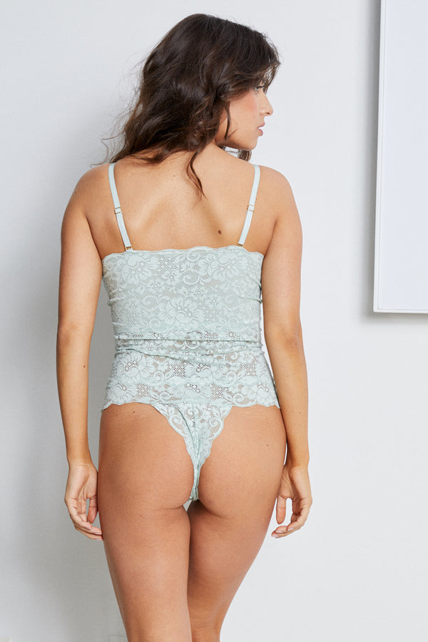 light blue lace-up reversible lingerie bodysuit made of stretch lace. | Model is wearing Size M