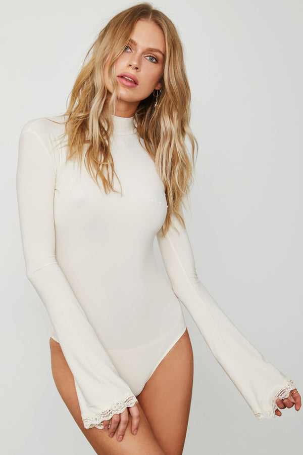 white creme knit long sleeved flare sleeve open back bodysuit machine washable