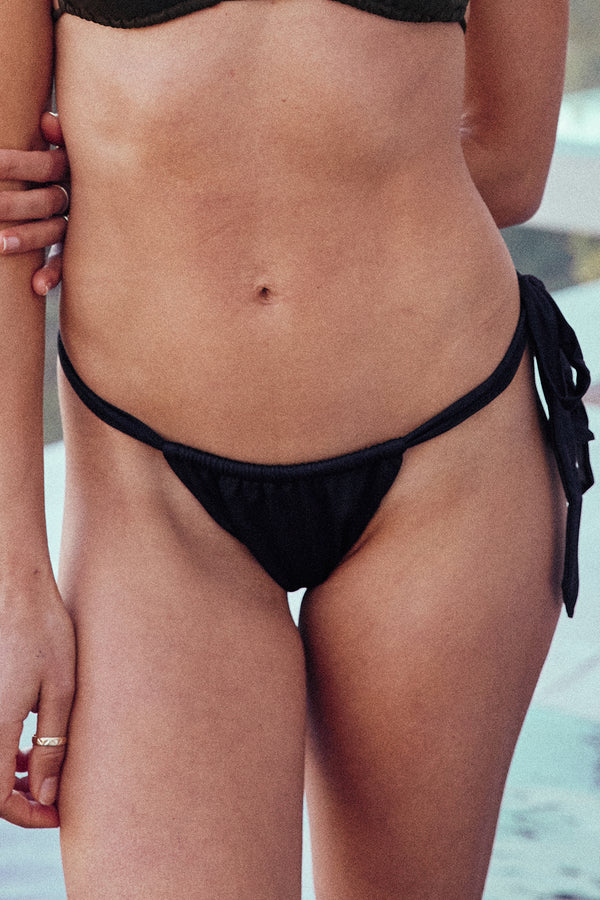 black vintage inspired side-tie cheeky bikini bottom eco-friendly & sustainable fabric