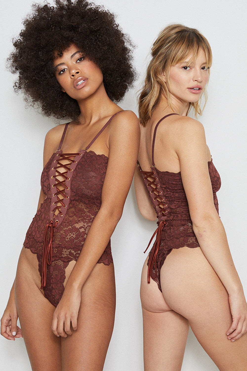 Brown lace-up reversible lingerie bodysuit made of stretch lace.