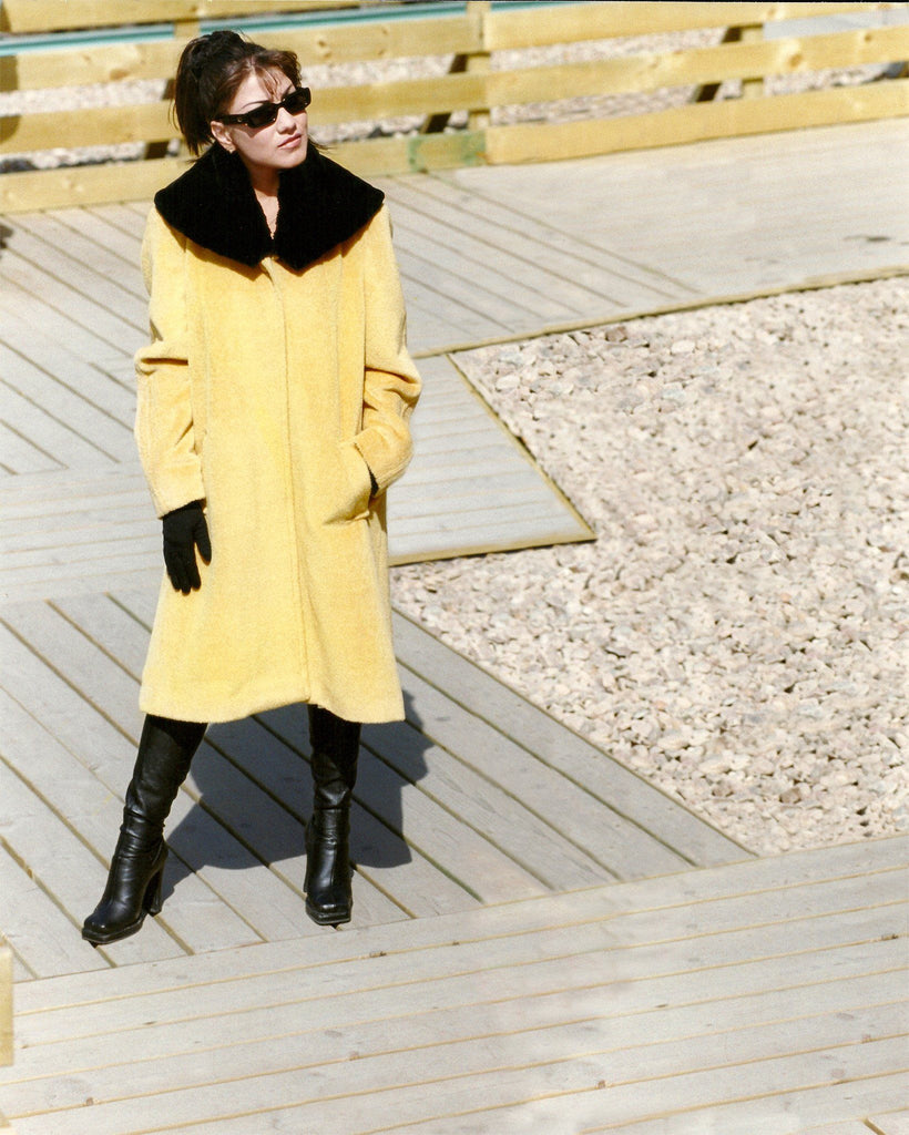 A line cashmere coat with fur trim