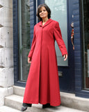 Long fitted cashmere coat with curved collar.