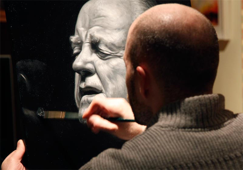 Oil painting of Christy Moore on easel