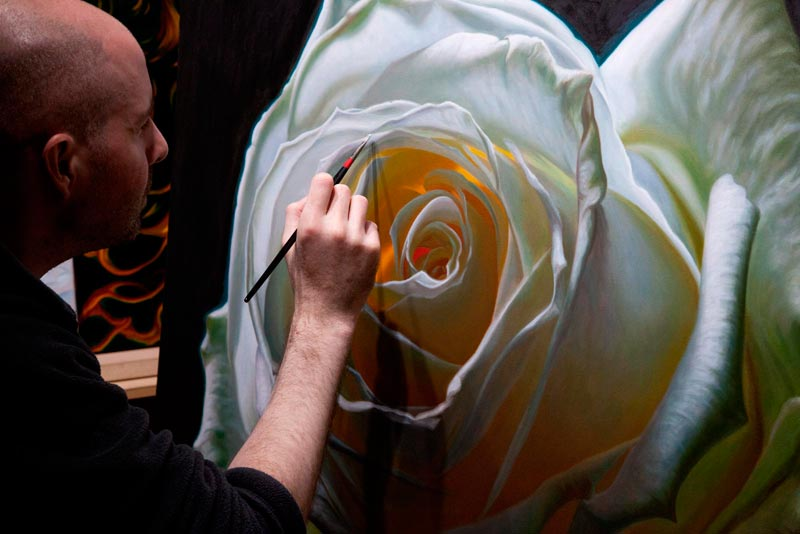 Artist Vincent Keeling painting a white rose oil painting