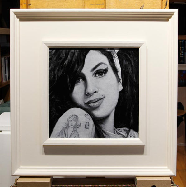 Amy Winehouse painting in white frame