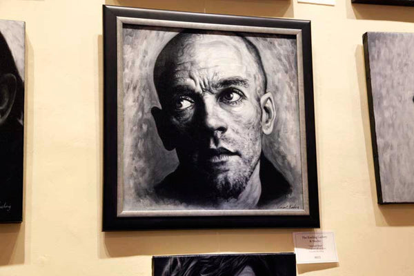 Framed Michael Stipe portrait hanging on gallery wall