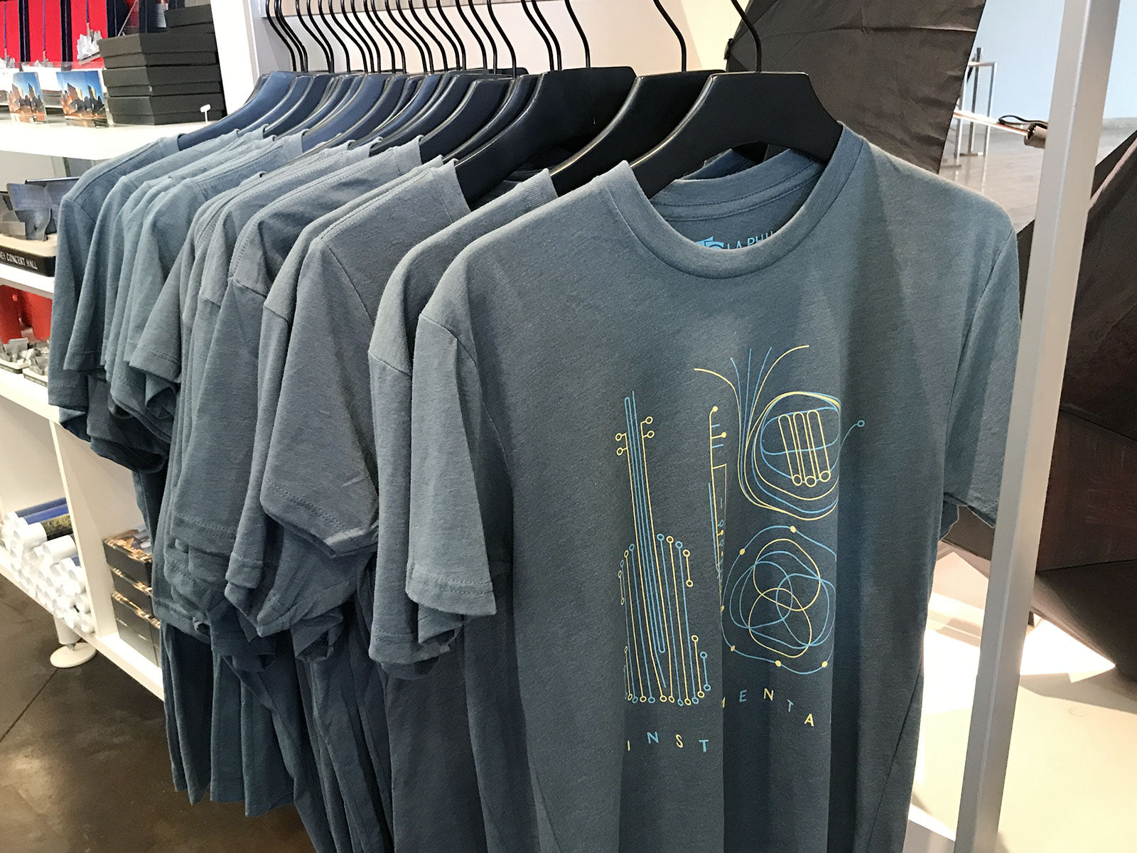 Story Spark designed t-shirts on the rack at the LA Phil Store