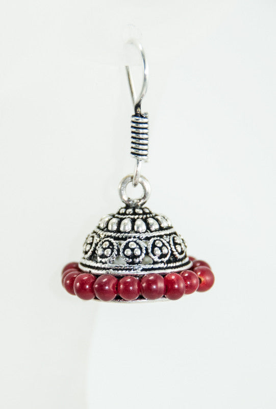 Black metal earrings with red beads - Desi Royale