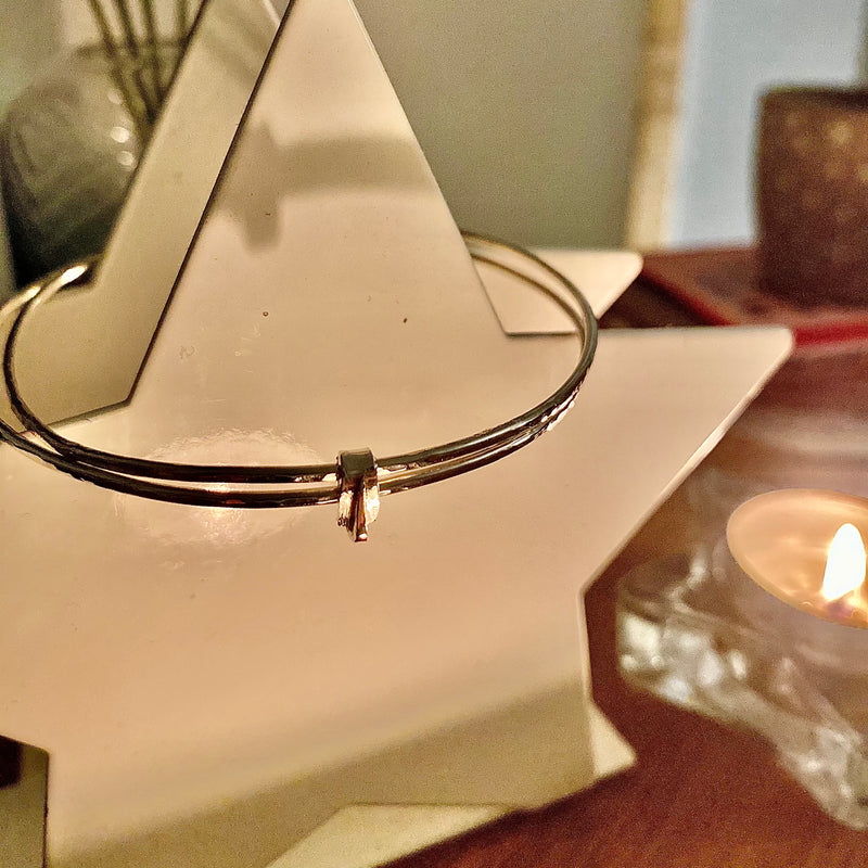Double silver bangle joined with buckle design link