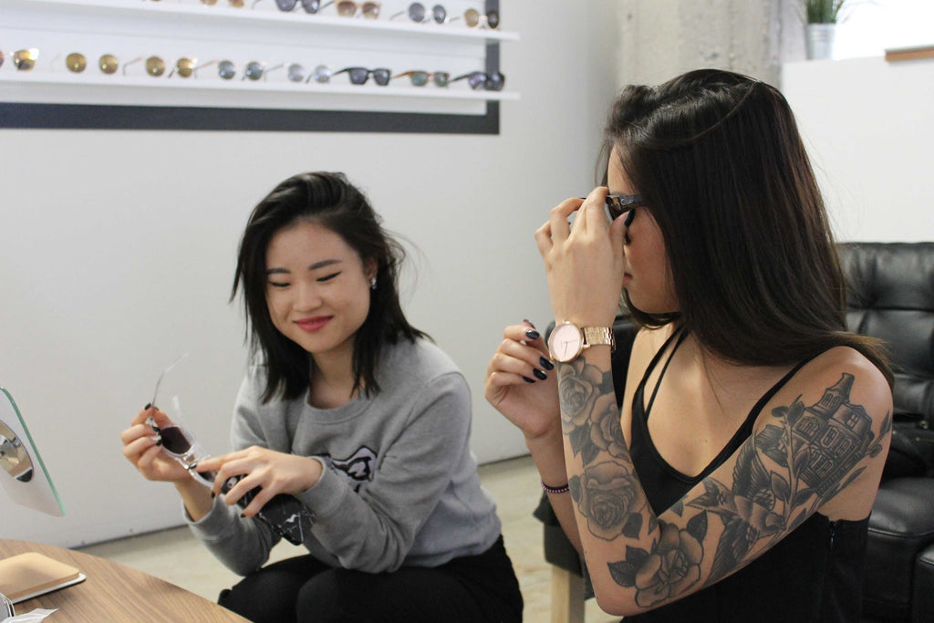 Yanin and Natalie trying Quay Sunglasses